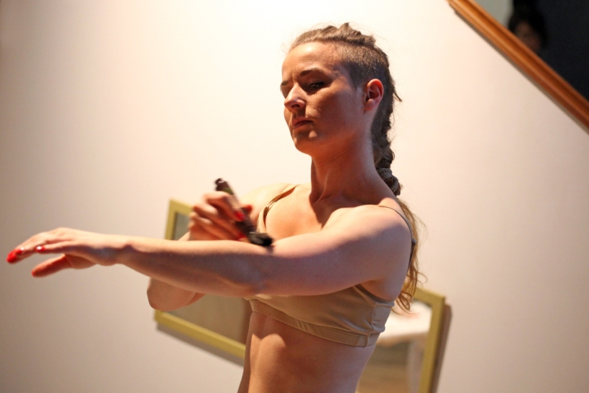 Laura McGee performing 'The Politics of Competition/Compensate' at Ambition by Instigate Arts at HOMEmcr on Saturday 9th July 2016